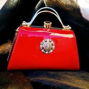Handbags - True Red Hard frame handbag..
